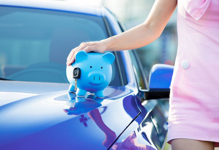 Cropped image woman customer, agent and new car, piggy bank, key on hood, isolated outside, outdoors. Dealership offering credit line, finance services. Lease, automobile purchase, financing concept